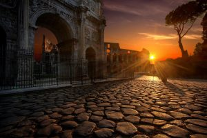 On Arch Of Constantine Colosseum Rome at sun dawn, Italy