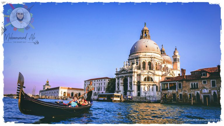 Amazing ride on a gondola through the canal in Venice, Italy