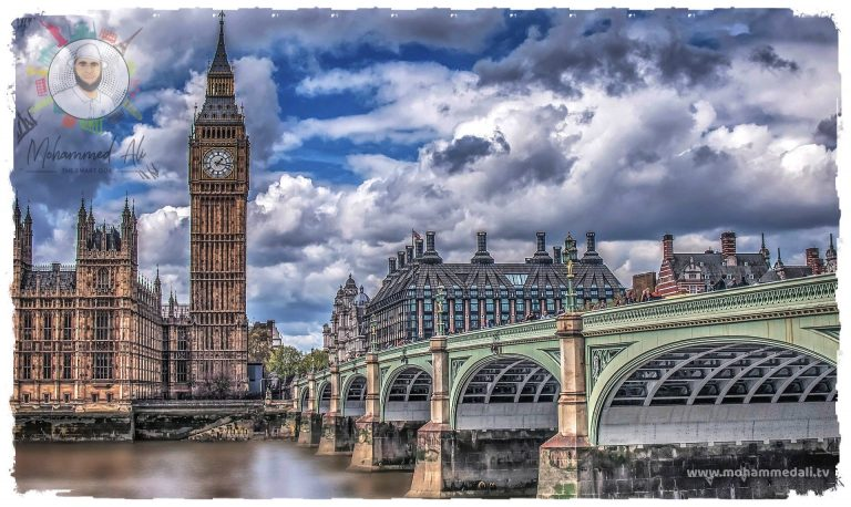 Walking along the river Thames with view on the The Big Ben and Houses of Parliament