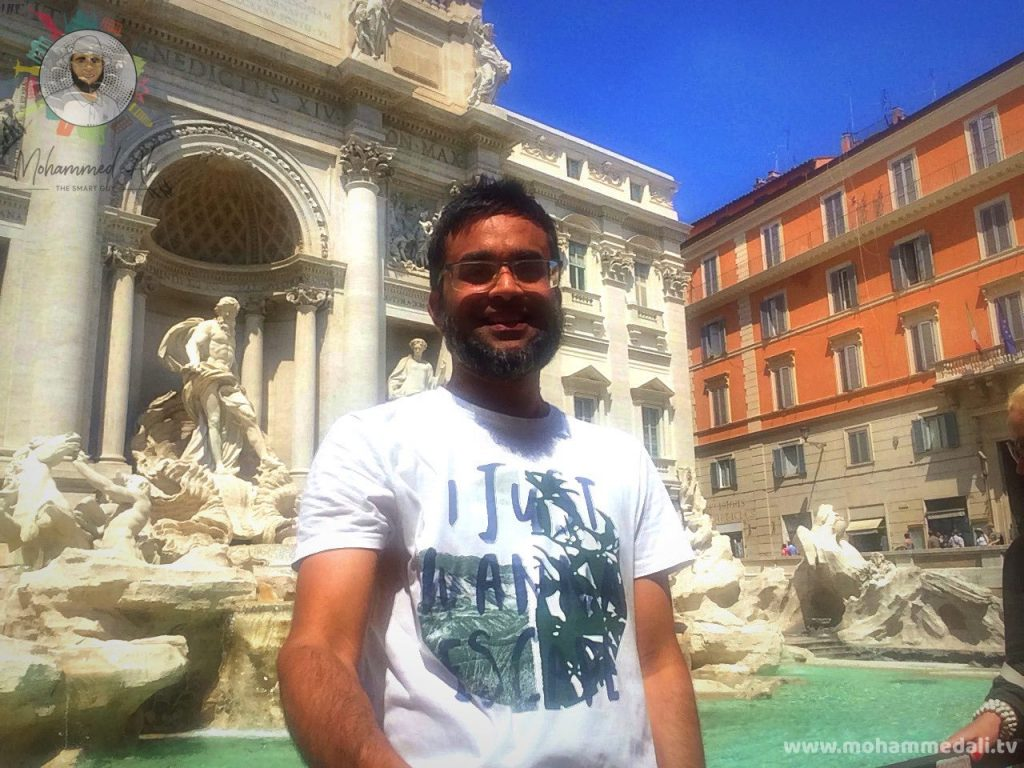 Standing in front of the famous Trevi Fountain in Rome, Italy