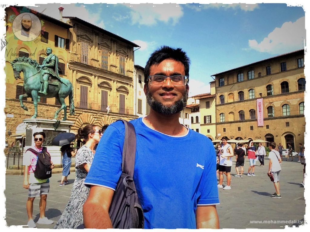 Standing happily on Piazza della Signoria in Florence