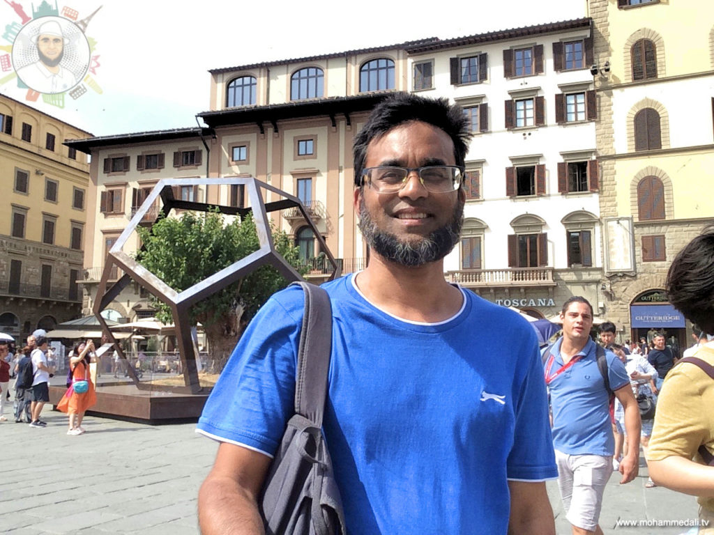 Standing in front of dodecahedron and a mulberry tree on Piazza della Signoria in Florence, Italy
